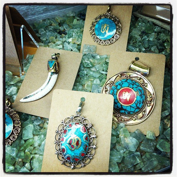 Charging our jewelry with #prehnite in the bottom our case!  #turquoise #brass #nepal #soulscapelife #encinitas