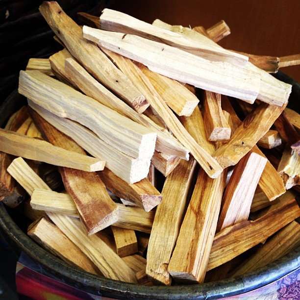 """Palo Santo is a mystical tree that grows on the coast of South America and is related to Frankincense, Myrrh and Copal.  In Spanish, the name literally means """"Holy Wood"""". Palo Santo is burned in ceremonies by Shamans and Medicine people for its energetically cleansing and healing properties similar to Sage.  It creates a pleasant, fresh smelling smoke with hints of mint and citrus. It raises your vibration in preparation for meditation and allows for a deeper connection to Source.  It is also said that Palo Santo enhances creativity and brings good fortune to those who are open to its Magic.Palo Santo is traditionally used for relieving common colds, flu symptoms, stress, asthma, headaches, anxiety, depression, inflammation, emotional pain and more…  The oil can also be used during massage work to seal intentions while calling in Spirit Allies for support and protection."""