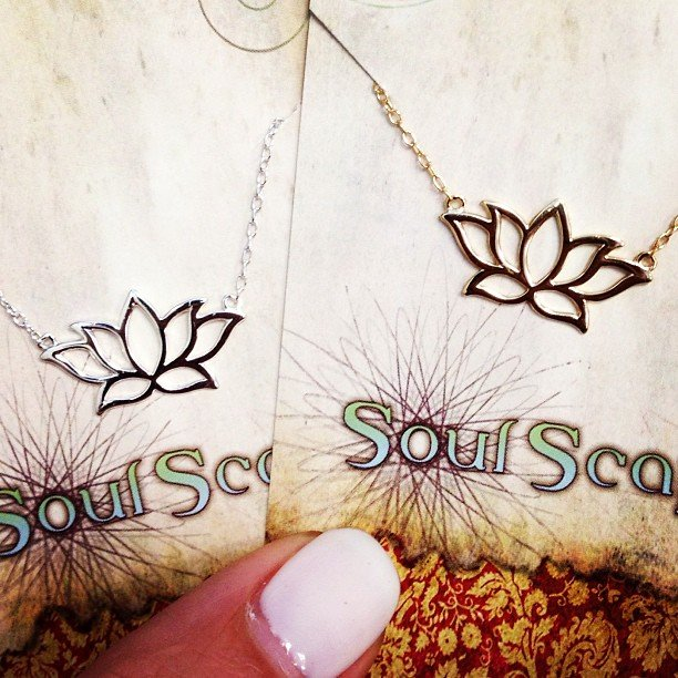 Our sweet lotus necklaces, perfectly dainty to layer with long malas. Sterling and gold filled.
