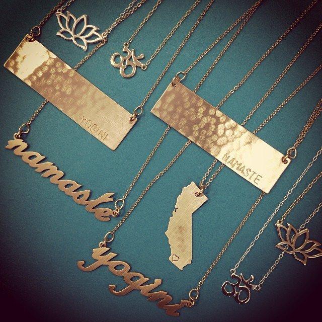 Stocked! #sterling and #goldfilled #om #lotus #namaste #yogini #iheartsandiego