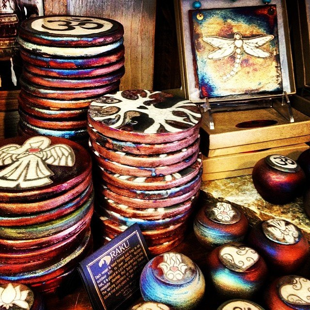 We love our Locally made Raku pottery! perfect little gifts for everyone on your list! #dreamjar #dreamcatcher hanging tiles, #angels, plates with so many mystical symbols on them!