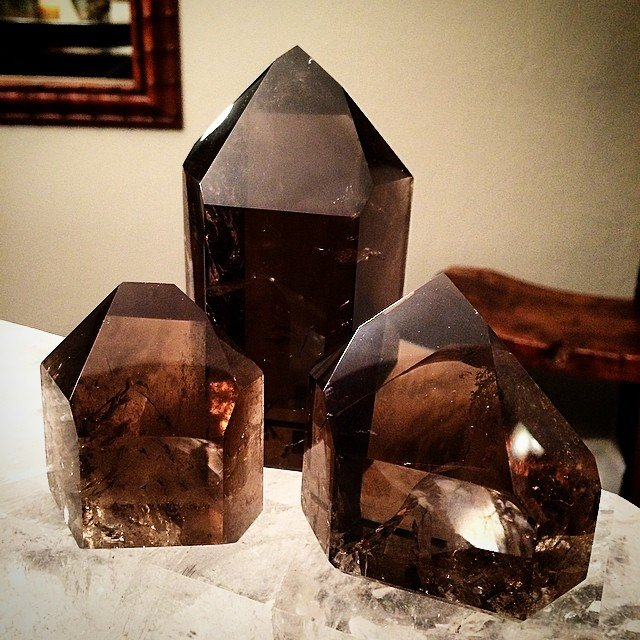 "Today I opened the #smokeyquartz box, I unpacked and shined them up, and set my intention for them to attract whomever belongs to them. Each day I have been revisiting my books, refreshing my knowledge of each crystal and mineral, sitting, holding and absorbing the different energies they bring along. I feel like I have found long lost friends I forgot I had, and the time is too short before they go again.... my favorite bit of info, ""smokey quartz is used in assisting in making wishes come true by grounding their essence in reality."" Love it."