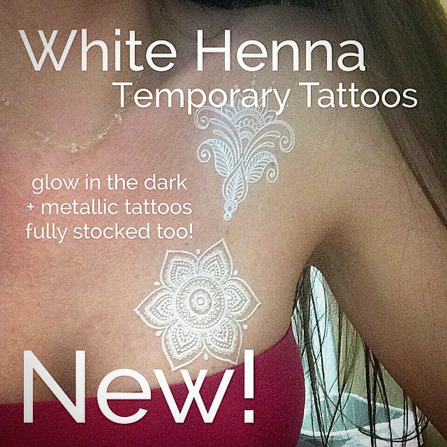 We LOVE our new #white #henna temporary tattoos! We are also stocked with all your favorite flash tattoos, from #feather to #Hamsa  sheets, some even glow in the dark!