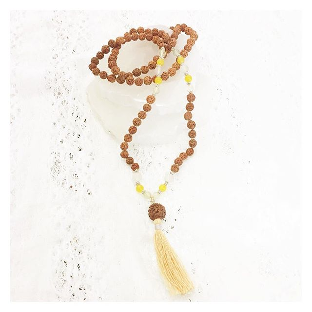 Keep your #zen on all day long with #malabeads . We're digging the #traditional #rudrakshabead style with colorful bursts of #honeyopal and #agate from #malacollective . The #frangipani #mala has us dreaming of #tropical escapes during these winter months!