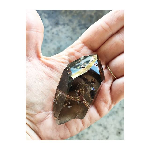 We're randomly giving away another #crystal ! This #smokeyquartz with #red #epidote , an #ultimate #wishingstone , is ready to go home with one #lucky shopper this evening! Could it be you?